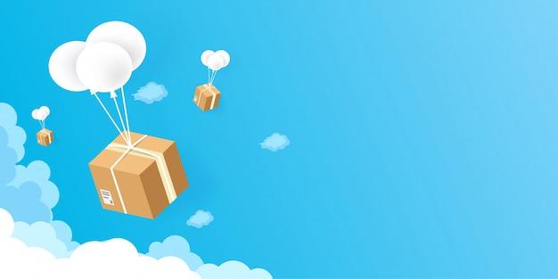Lieferservices und e-commerce-pakete ballons fliegen auf blauem himmel hintergrund