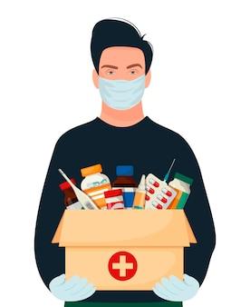 Lieferung von medikamenten nach hause. ein mann in seinen händen trägt medizinisches material in einer kiste.