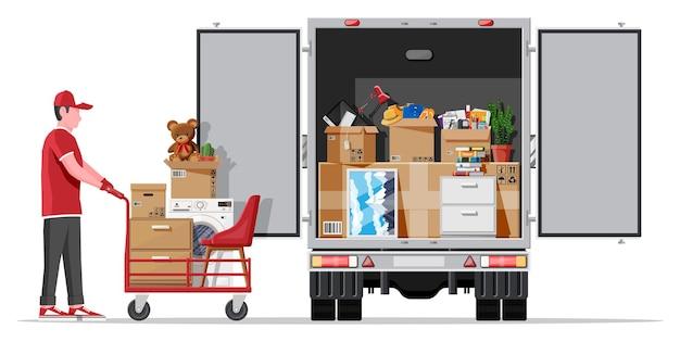 Lieferwagen voller hausrat drinnen. umzug in neues haus. familie in ein neues zuhause umgezogen. kisten mit waren. pakettransport. computer, lampe, kleidung, bücher. flache vektorillustration