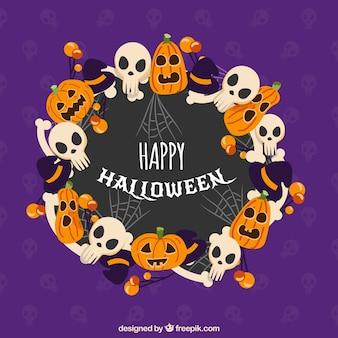 Lila hintergrund mit halloween-dekoration
