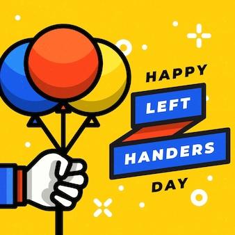 Linkshänder tag mit hand hält luftballons