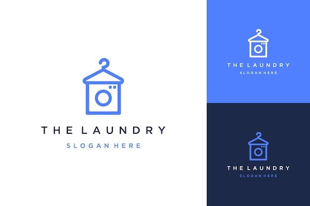 Logo-design-wäsche oder kleiderbügel mit waschmaschine