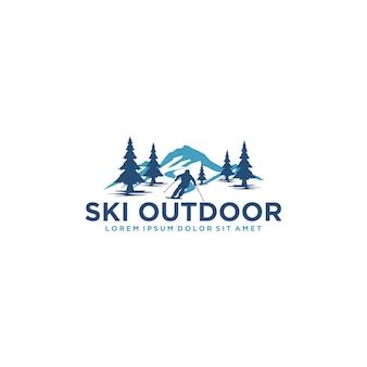 Logo zum skifahren mit einer silhouette des skifahrers