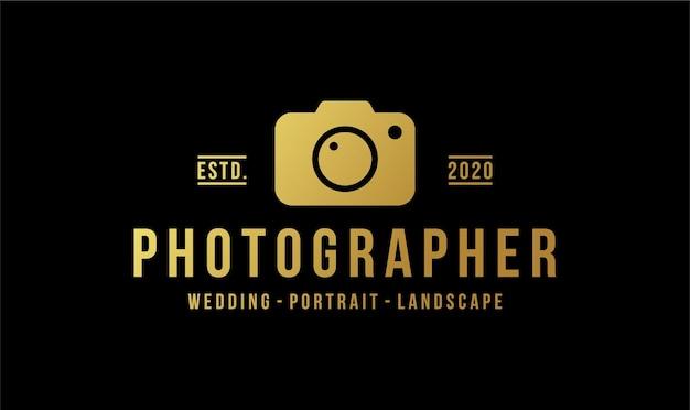 Logodesign für kamerafotografen mit goldener farbe. Premium Vektoren