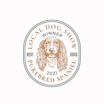 Lokale hundeausstellung rahmenabzeichen oder logo vorlage handgezeichnete spaniel rasse gesichtsskizze