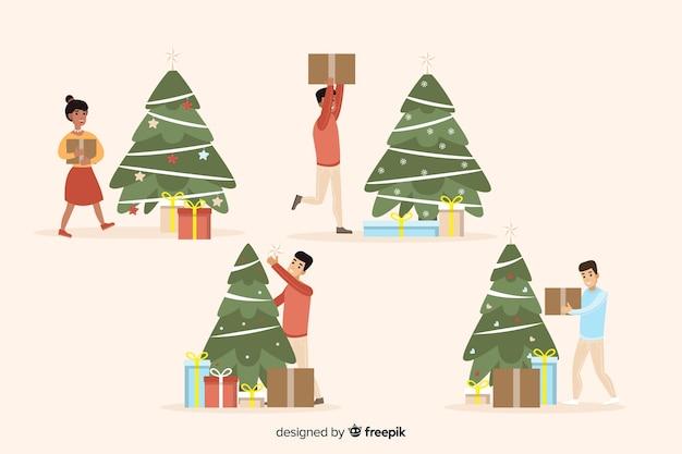 Lokalisierte glückliche menschen, die weihnachtsbaum verzieren