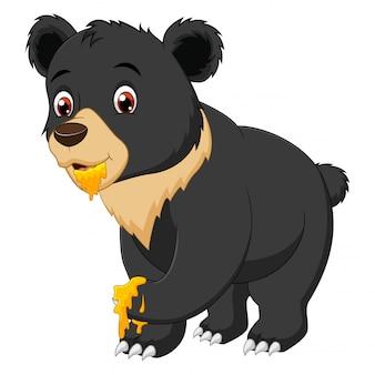Lustige bärenkarikatur, die süßen honig isst