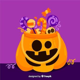 Lustige halloween-kürbistasche auf flachem design