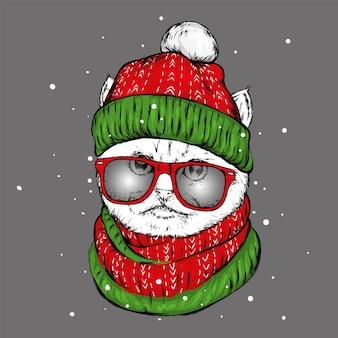 Lustige katze in einer weihnachtsmütze und brille. vektorillustration.