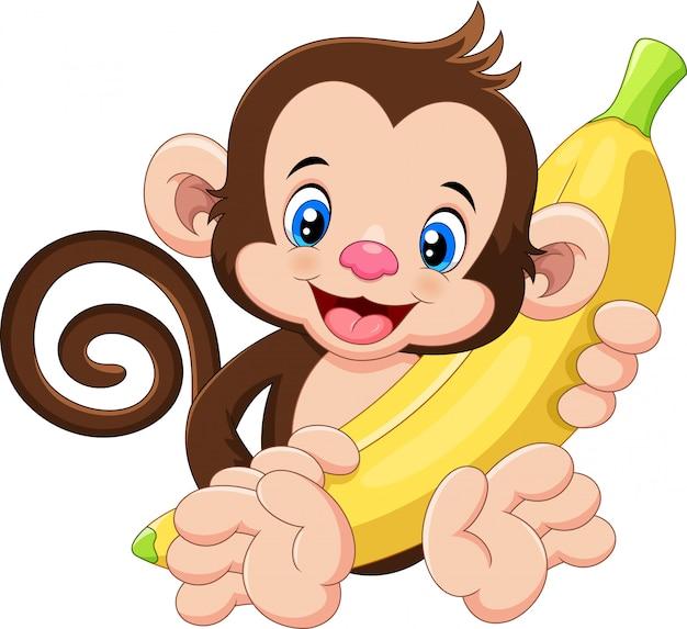 Lustiger affe der karikatur, der banane hält