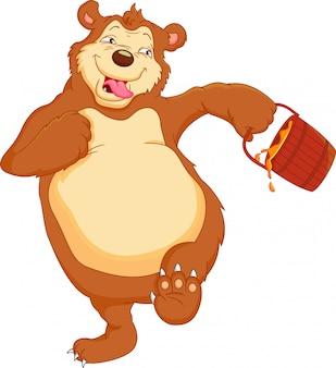 Lustiger bärenkarikatur mit honig
