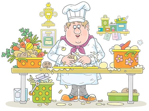 Lustiger fetter koch in einem weißen hut und in der uniform, die an seinem küchentisch stehen und frische kartoffeln schälen