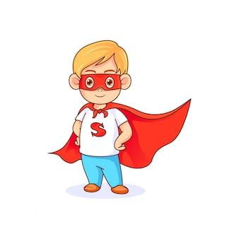 Lustiger kleiner junge in der superheldhaltung, die rote maske und rotes kap trägt