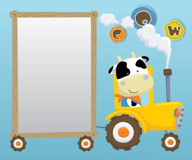 Lustiger kuhkarikatur, der traktor fährt, während hölzerne rahmengrenze ziehen