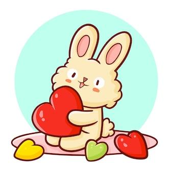 Lustiges und niedliches kaninchen, das eine herzform im kawaii gekritzelstil hält