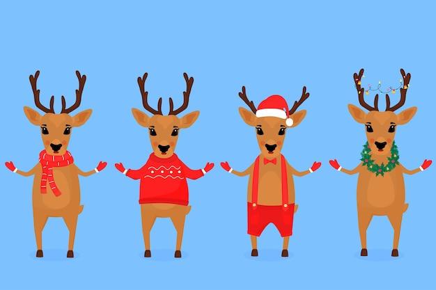 Lustiges weihnachtsrentier in einer weihnachtsmannmütze, in einem schal, mit einer girlande, in kurzen hosen an hosenträgern, in einem pullover.