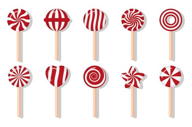 Lutscher weihnachtsbonbons mit verschiedenen spiralmustern gesetzt. rot-weiß-leckerbissen für den hauptferienwinter. süßer zucker cartoon noel candy stick rund mit verdrehtem design. isolierte illustration