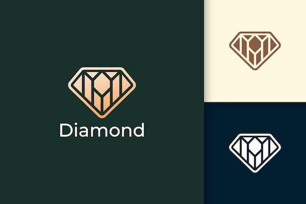 Luxus-edelstein- oder juwelenlogo in rautenform mit goldfarbe