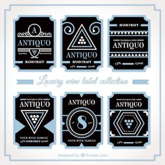 Luxus-pack von blauen und schwarzen etiketten