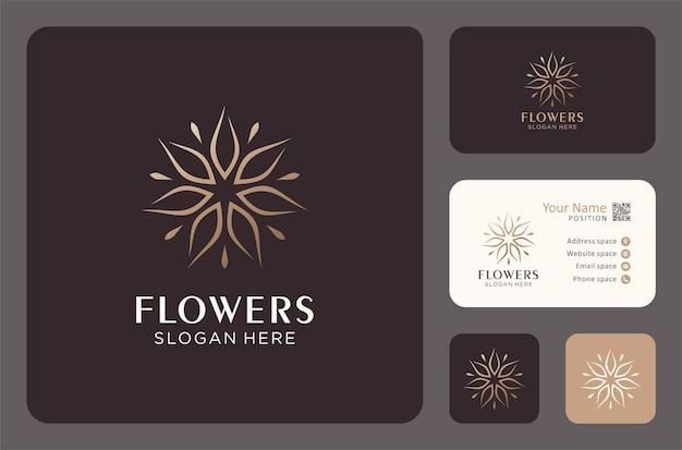 Luxusblumenlogodesign mit visitenkartenschablone.