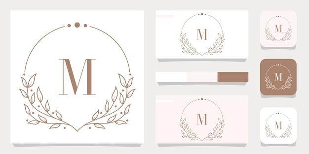 Luxusbuchstabe m logoentwurf mit blumenrahmenschablone, visitenkartenentwurf