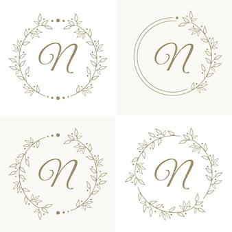 Luxusbuchstabe n-logoentwurf mit blumenrahmenhintergrundschablone