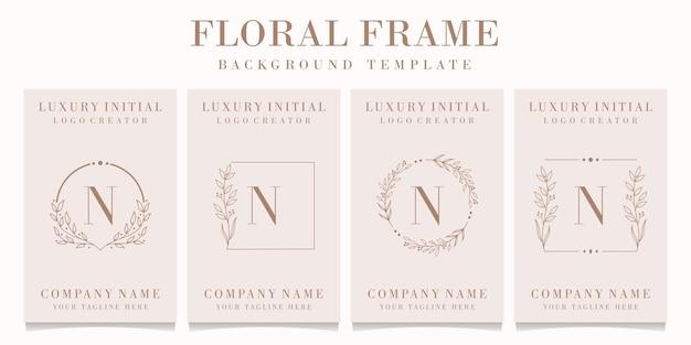 Luxusbuchstabe n-logoentwurf mit blumenrahmenschablone