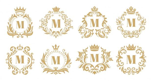 Luxusmonogramm. weinlesekronenlogo, goldene ziermonogramme und heraldischer kranzverzierungsvektorsatz