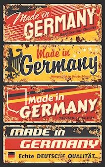 Made in germany rostige metallplatte, vintage rostblechschild mit deutscher flagge, adler und typografie.