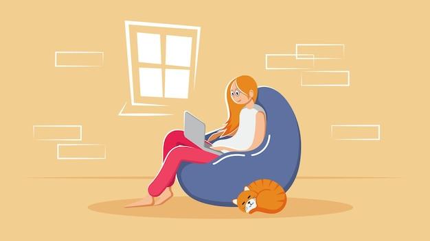 Mädchen arbeitet am fenster mit einem laptop