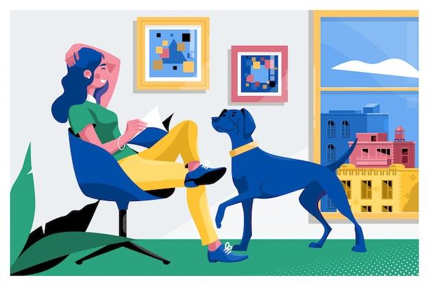 Mädchen, das ein buch mit ihrem hund liest