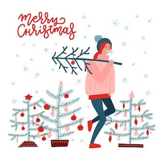 Mädchen, das einen weihnachtsbaum trägt. frohe weihnachten und ein glückliches neues jahr.