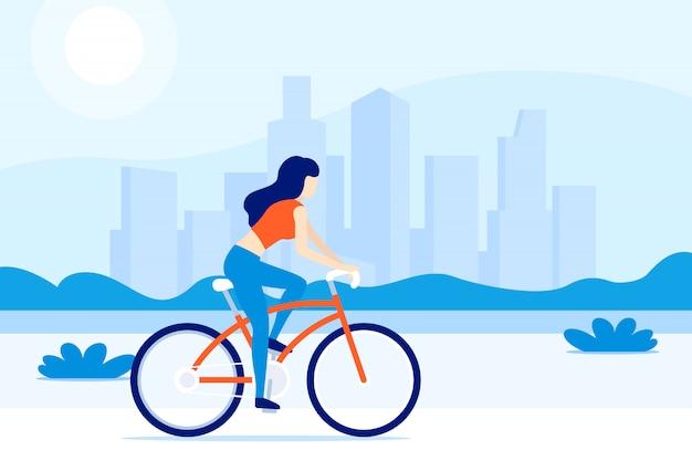 Mädchen, das fahrrad in der stadt reitet,
