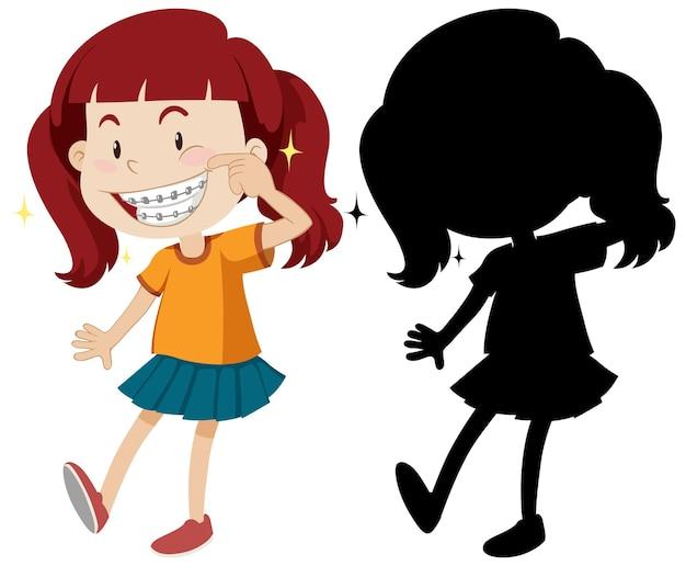 Mädchen, das hosenträger mit seiner silhouette trägt