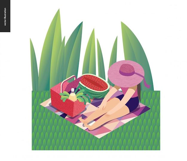 Mädchen, das im gras mit einem farbbandsonnenhut sitzt