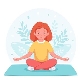 Mädchen, das im lotussitz meditiert gymnastisches yoga und meditation für kinder