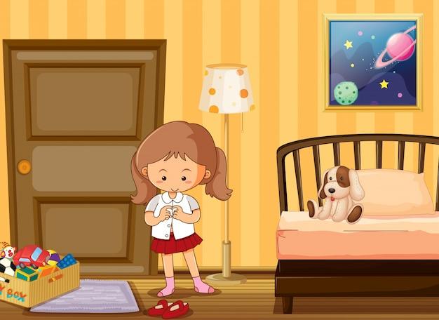 Mädchen, das in der schuluniform im schlafzimmer ankleidet