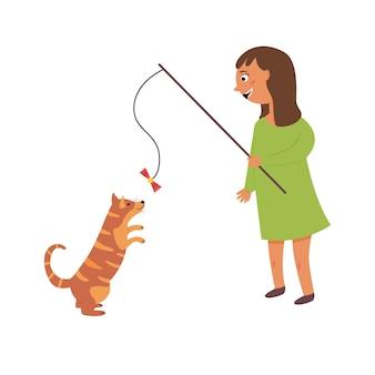 Mädchen, das katze spielt