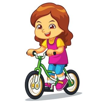 Mädchen, das neues grünes fahrrad reitet.