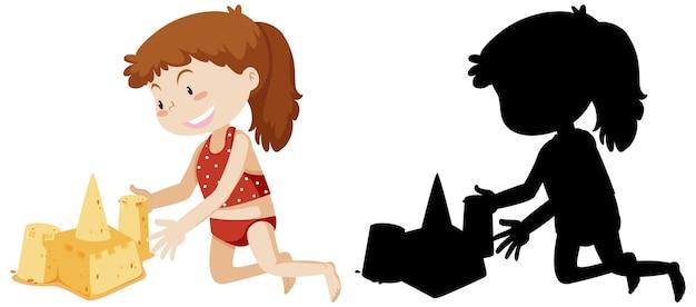 Mädchen, das sandburg mit seiner silhouette baut