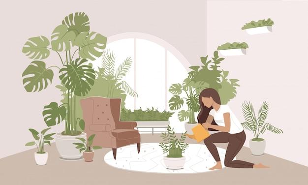 Mädchen, das sich kümmert und zz-pflanze mit trichter an ihrem hausgarten wässert. indoor garten hobby.