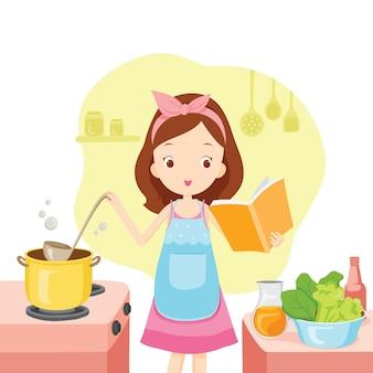Mädchen, das suppe mit kochbuch in der küche kocht