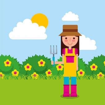 Mädchen der gärtner hält rechen blumen büsche