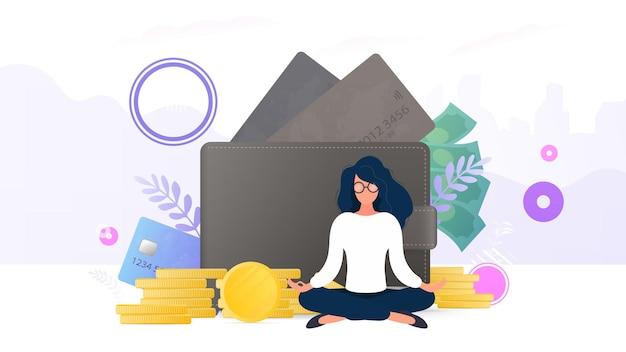 Mädchen, die auf dem hintergrund einer brieftasche mit kreditkarten und goldmünzen meditieren.