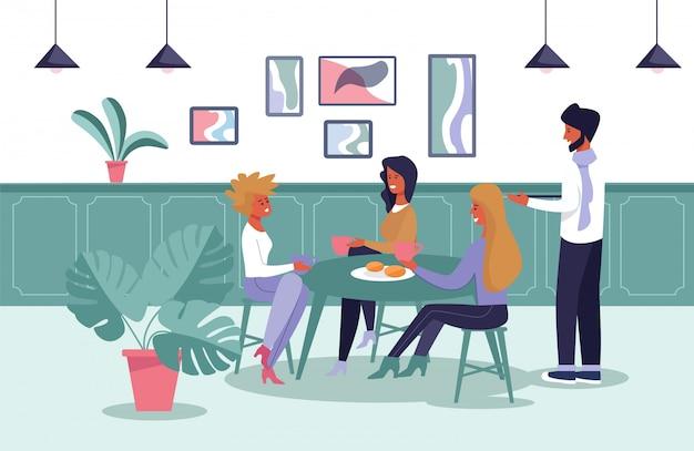 Mädchen, die kaffee trinken und snack am café essen