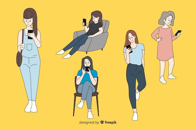 Mädchen, die smartphones in der koreanischen zeichnungsart halten