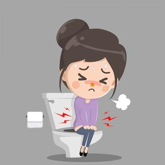 Mädchen hat bauchschmerzen und muss kacken. sie sitzt und spült die toilette richtig.