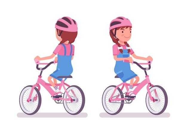 Mädchen im alter von 7 bis 9 jahren, kind im schulpflichtigen alter, das fahrrad fährt
