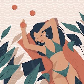Mädchen im badeanzug liegt auf einem teppich, umgeben von tropischen pflanzen