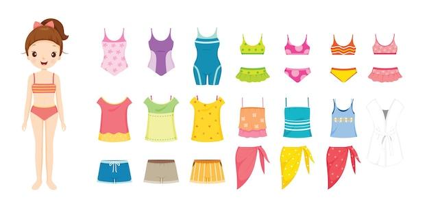 Mädchen im bikini und in der kleidung, die für sommer eingestellt werden